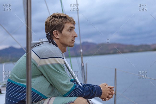 Man on sailboat sailing in sea, Lombok, Indonesia