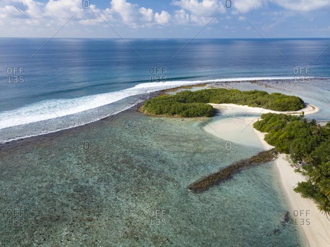 Tropical island coastline, Thulusdhoo, Male, Maldives
