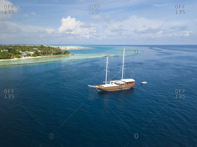 Coastline and yacht, Thulusdhoo, Maldives
