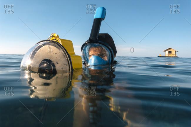 Female diver with camera, Perebutan, Bali, Indonesia