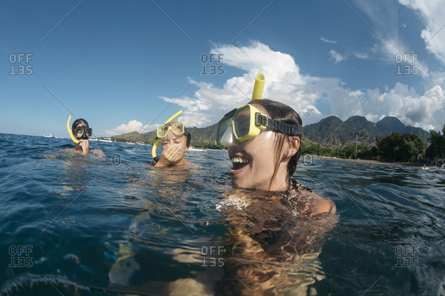 Three women snorkeling, Perebutan, Bali, Indonesia