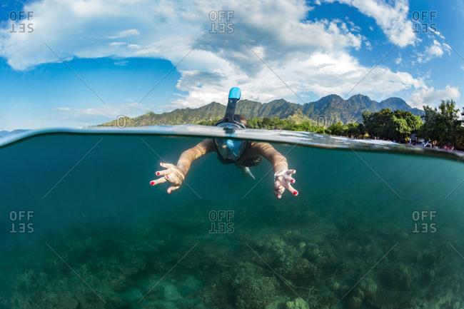 Woman snorkeling, Perebutan, Bali, Indonesia