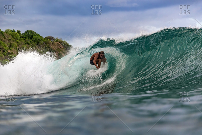 Surfer on wave, Sumbawa, Indonesia