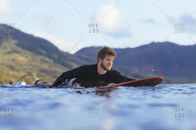 Male surfer approaching a wave