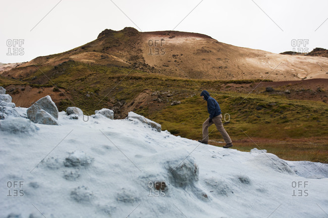 Hiker passing by mineral deposit, Iceland