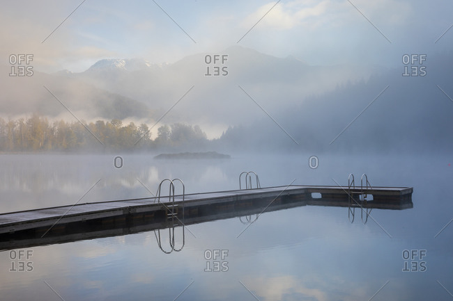 Jetty on shore of One Mile Lake at sunrise, Pemberton, British Columbia, Canada