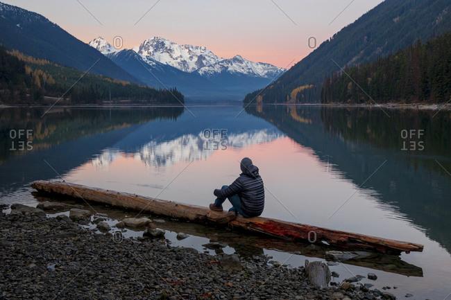 Man watching sunset at Duffey Lake, Duffey Lake Provincial Park, British Columbia, Canada