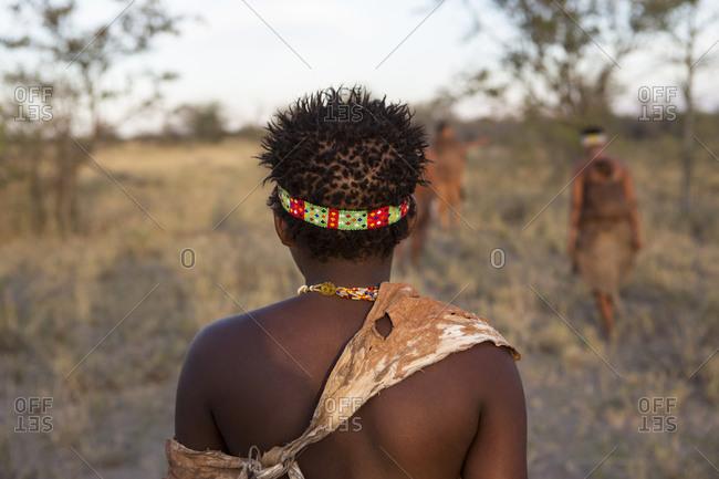 Rear view of a San Bushman, head and shoulders