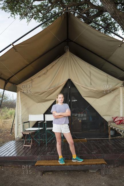 Twelve year old girl and tent, Kalahari Desert, Makgadikgadi Salt Pans, Botswana