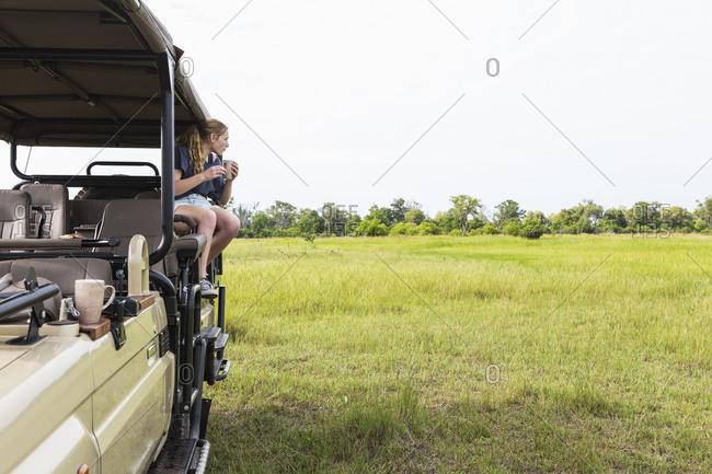 Teenage girl on safari vehicle, Botswana
