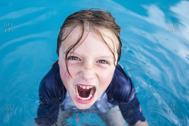An excited six year old boy in a swimming pool