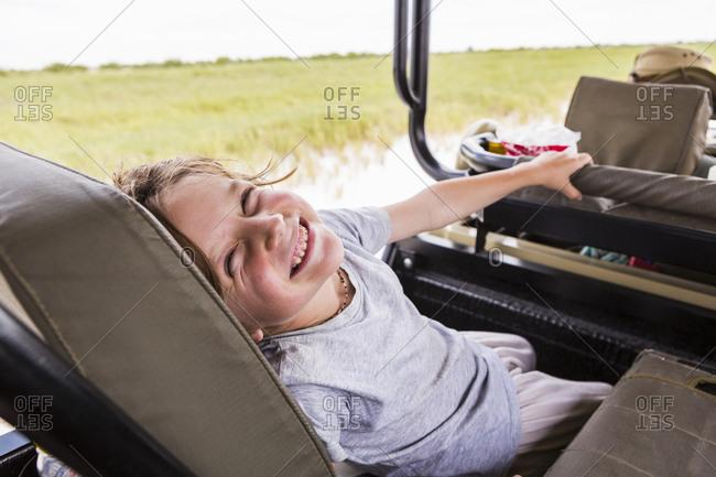 smiling Six year old boy in safari vehicle, Botswana