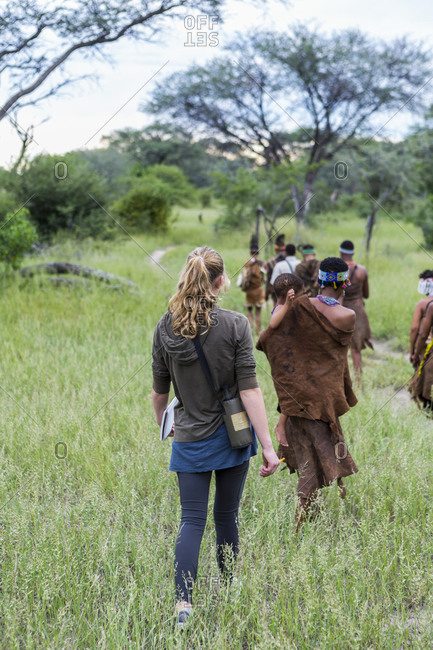 Tourists on a walking trail with members of the San people, bushmen.