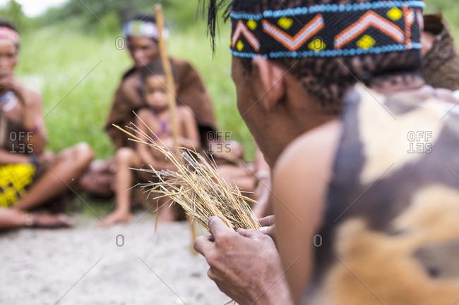 Bushman creating sparks for a fire, a cultural exchange demonstration by the San People