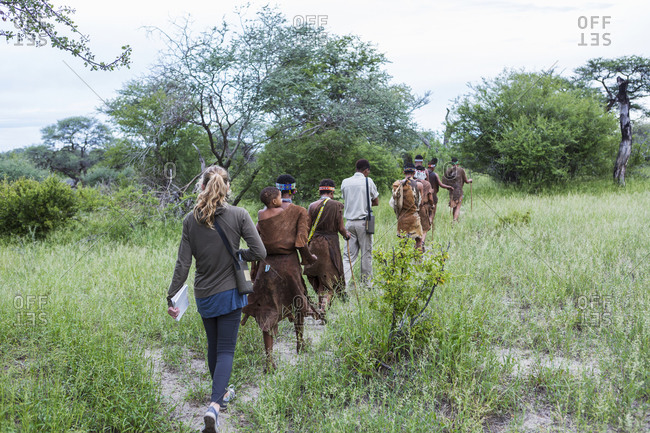 Tourists on a walking trail with members of the San people bushmen.