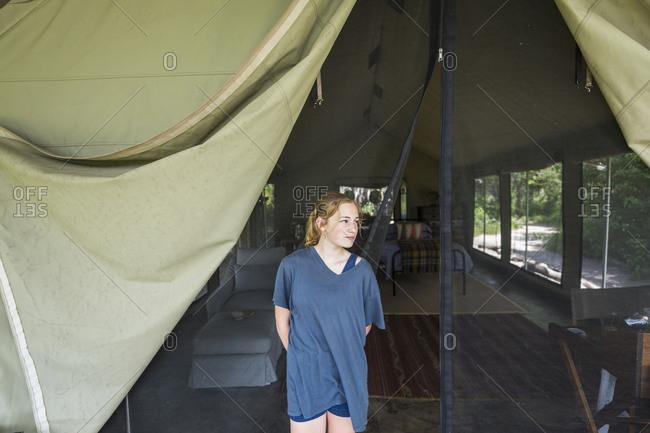 portrait of Teenage girl outside tented safari camp