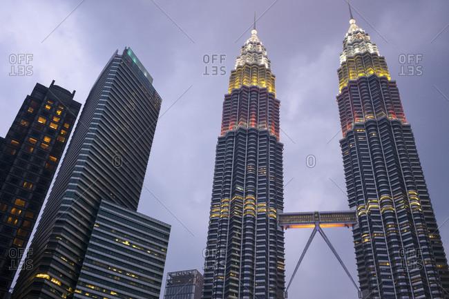 September 2, 2019: Kuala Lumpur skyline with the Petronas Twin Towers, designed by Cesar Pelli, illuminated at dusk, Kuala Lumpur, Malaysia, Southeast Asia, Asia