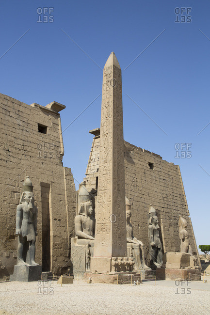March 18, 2020: Colossi of Ramses II in front of Pylon, Obelisk, Luxor Temple, UNESCO World Heritage Site, Luxor, Thebes, Egypt, North Africa, Africa