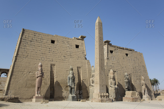 March 18, 2020: Six Colossi of Ramses II in front of Pylon, Obelisk, Luxor Temple, UNESCO World Heritage Site, Luxor, Thebes, Egypt, North Africa, Africa