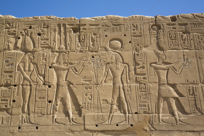 March 17, 2020: Reliefs of Deities and a Pharaoh on the right, Karnak Temple Complex, UNESCO World Heritage Site, Luxor, Thebes, Egypt, North Africa, Africa