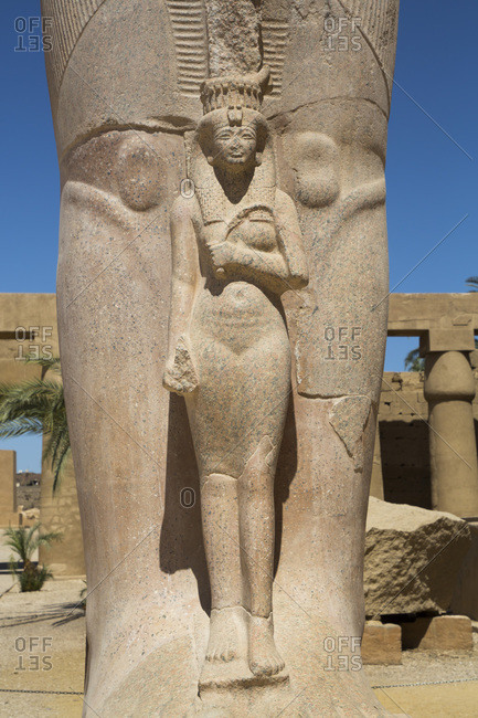 Statue of Nefetari, at base of statue of Ramses II, Great Court, Karnak Temple Complex, UNESCO World Heritage Site, Luxor, Thebes, Egypt, North Africa, Africa