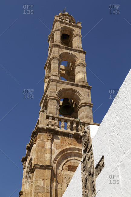 Stone bell tower of the Church of the Panagia, a Greek Orthodox place of worship on Lindos on Rhodes, Dodecanese, Greek Islands, Greece, Europe