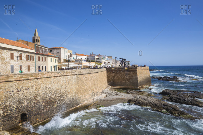 June 6, 2019: View of ancient city walls and the historical center, Alghero, Sardinia, Italy, Mediterranean, Europe