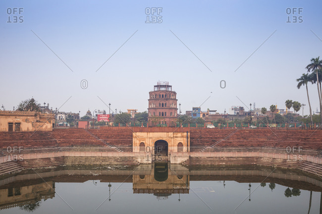 February 8, 2019: Hussainabad pond and Satkhanda watchtower, Lucknow, Uttar Pradesh, India, Asia
