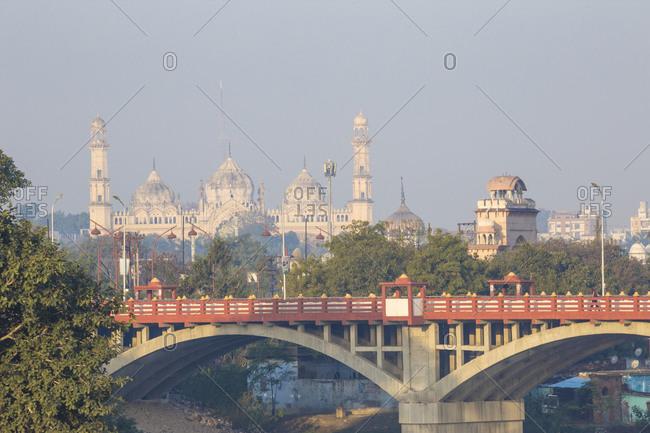 February 9, 2019: Bridge over Gomti River with Bara Imambara in distance, Lucknow, Uttar Pradesh, India, Asia