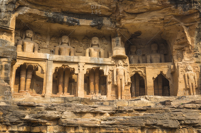 Jain images cut into the cliff rock of Gwalior Fort, Gwalior, Madhya Pradesh, India, Asia