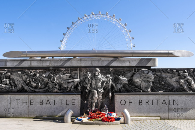 March 23, 2020: The RAF Battle of Britain Memorial Monument by British sculptor Paul Day, with the London Eye behind, London, England, United Kingdom, Europe