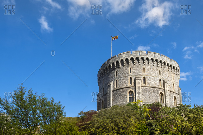 The round Norman Keep (Round Tower) in Windsor Castle with the Queen's flag (Royal Standard) flying, Windsor, Berkshire, England, United Kingdom, Europe