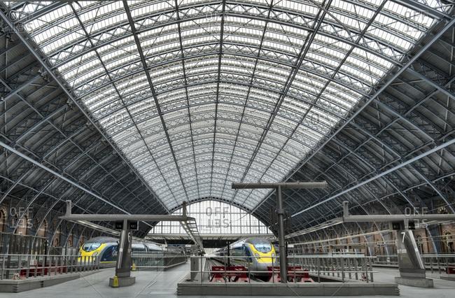 April 1, 2020: Eurostar Trains waiting on platforms in the 19th century wrought iron interior of St. Pancras Railway station, London, England, United Kingdom, Europe