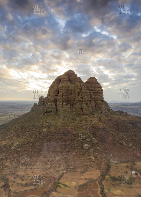 Clouds at sunset over the tall rocks of Gheralta Mountains, aerial view by drone, Hawzen, Tigray Region, Ethiopia, Africa