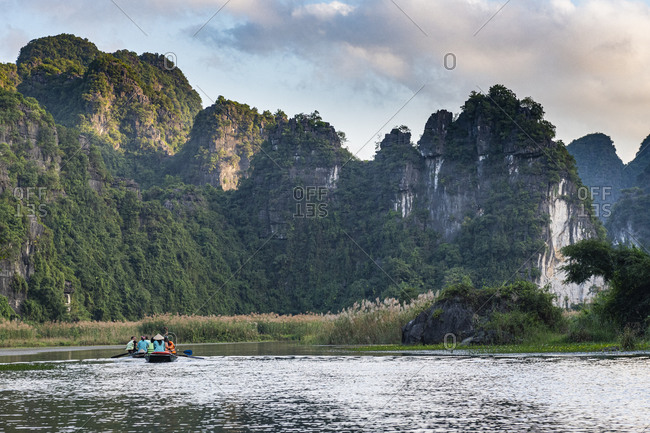 December 23, 2019: Limestone mountains in the scenic Trang An Landscape Complex, UNESCO World Heritage Site, Vietnam, Indochina, Southeast Asia, Asia