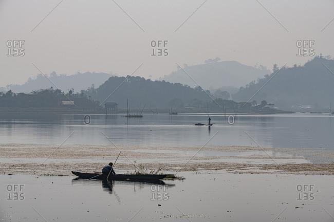 February 19, 2020: Fisherman in his canoe fishing, Loktak Lake, Moirang, Manipur, India, Asia