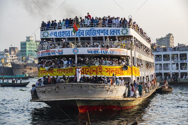 February 29, 2020: Overloaded passenger ferry with pilgrims on the Dhaka River, Port of Dhaka, Dhaka, Bangladesh, Asia