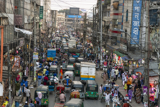 February 29, 2020: Overcrowded completely with rickshaws, a street in the center of Dhaka, Bangladesh, Asia