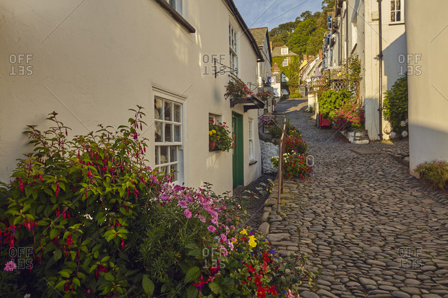 July 25, 2017: Steep streets and classic cottages at an iconic coastal village, Clovelly, on Devon's north coast, Devon, England, United Kingdom, Europe