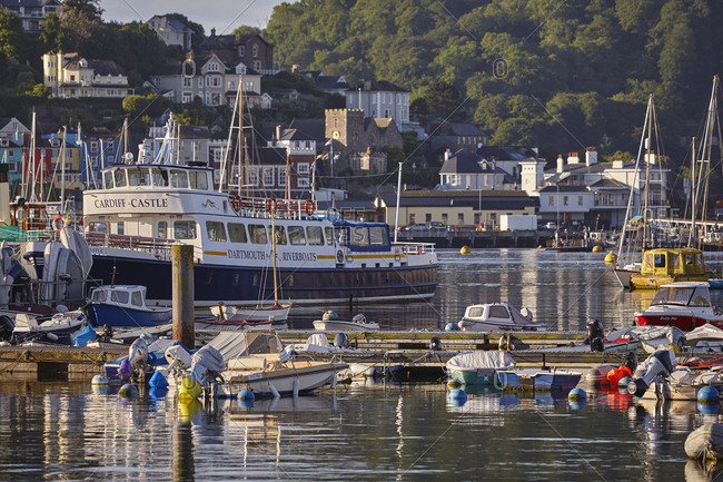 June 7, 2017: A crowd of boats moored in the harbour in the estuary of the River Dart, at Dartmouth, on the south coast of Devon, England, United Kingdom, Europe