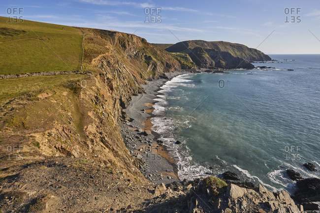 Cliffs along Devon's Atlantic coast bathed in late afternoon sunlight, Hartland Quay, north Devon, England, United Kingdom, Europe
