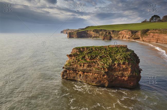 Red sandstone cliffs and rocks at Ladram Bay, in the Jurassic Coast UNESCO World Heritage Site, near Budleigh Salterton, East Devon, England, United Kingdom, Europe