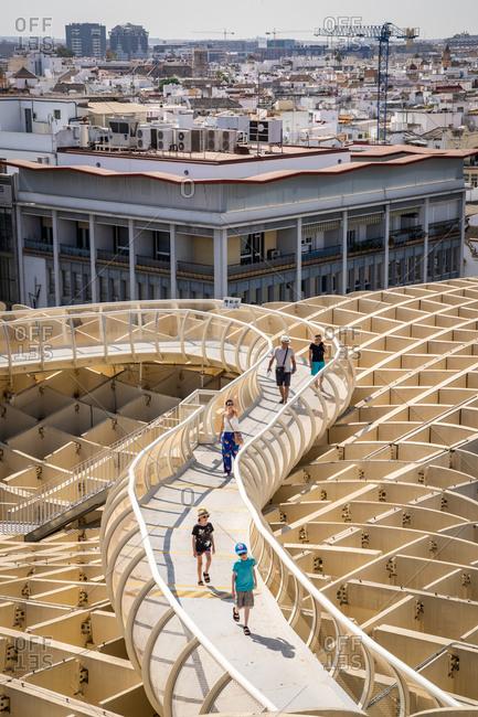 August 11, 2018: People on the elevated walking platform of Seville's Metropol Parasol, La Encarnacion Square, Seville, Andalusia, Spain, Europe