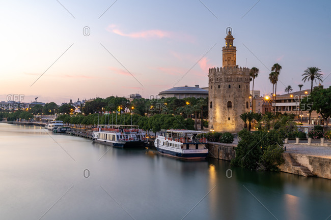 August 12, 2018: Sunset at Torre del Oro (Tower of Gold), a watchtower on the bank of the Guadalquivir River in Seville, Andalusia, Spain, Europe