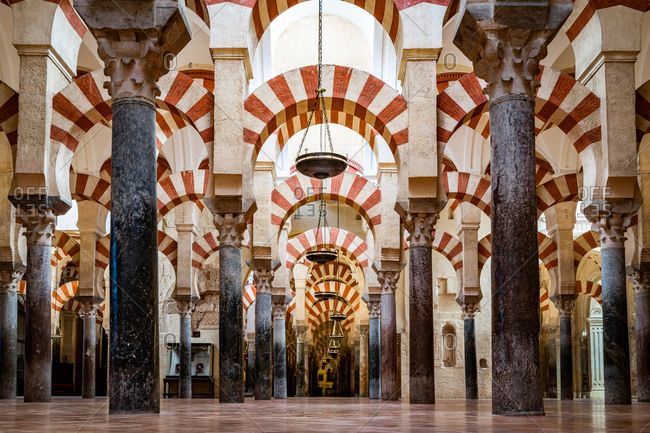 August 14, 2018: The red and white stone Arches of Mezquita de Cordoba (Great Mosque) (Cordoba Cathedral), UNESCO World Heritage Site, Cordoba, Andalusia, Spain, Europe