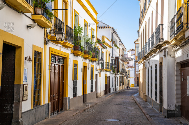 August 14, 2018: The white and yellow buildings of a typical Andalusian street in Cordoba, Andalusia, Spain, Europe