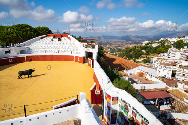 August 18, 2018: A view over Mijas bullring, Plaza de Toros, and the whitewashed buildings of the Andalusia town of Mijas Pueblo, Andalusia, Spain, Europe
