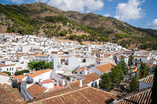 Mountains provide the backdrop to the white washed buildings of Mijas Pueblo, Andalusia, Spain, Europe