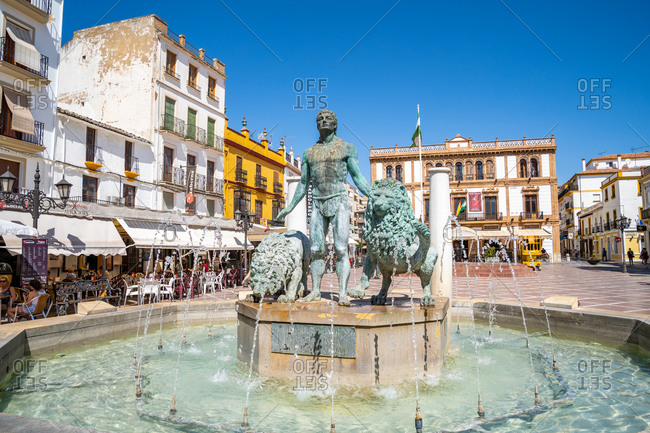 August 19, 2018: Statue of Hercules and two lions in a fountain at Plaza del Socorro, Ronda, Andalusia, Spain, Europe