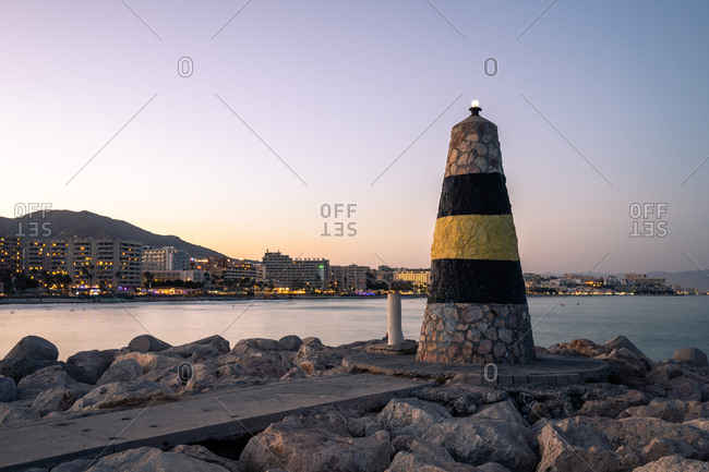 August 18, 2018: Faro de Levante lighthouse at Benalmadena Puerto Marina at sunset, Costa Del Sol, Andalusia, Spain, Europe